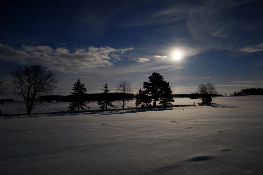 full moon above snowy landscape