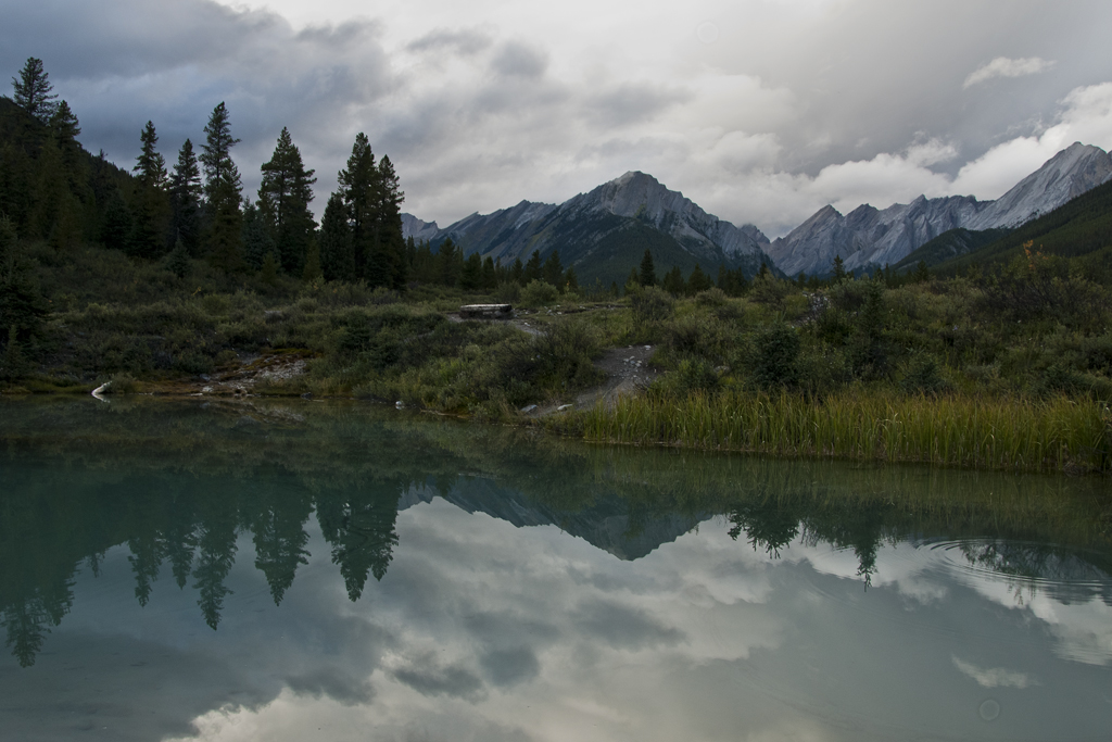 Mystic Peak reflected in the Ink Pots in Banff, AB.