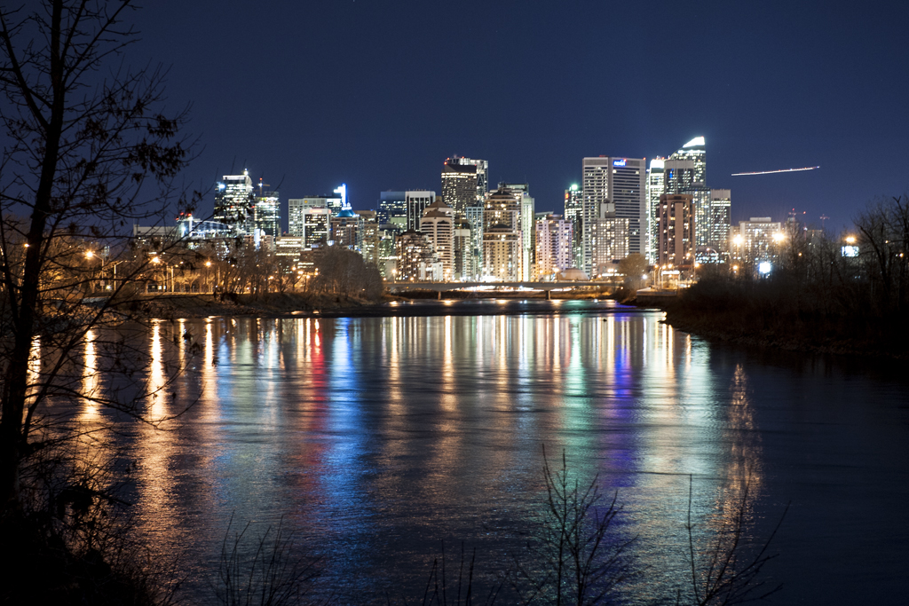 Downtown Calgary reflected in the Bow River.