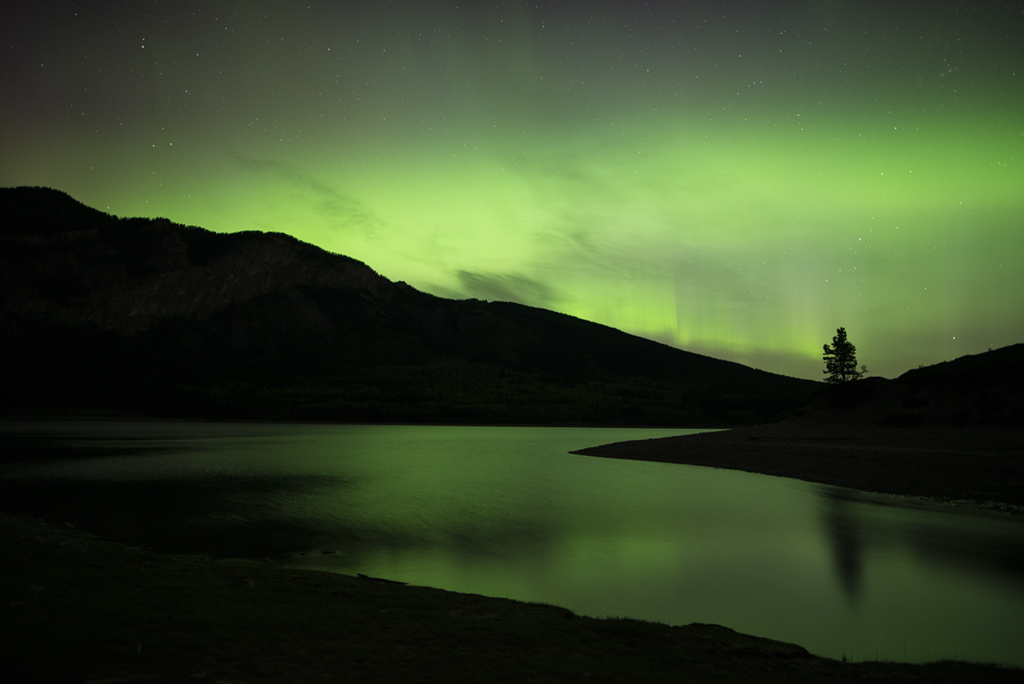 The northern lights reflected in Barrier Lake, Kananaskis
